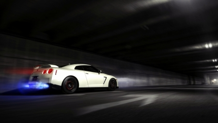 Car speeds down dark tunnel - light, lights, vehicle, motion, motion blur, blur, racecar, speed, car, dark, tunnel, white