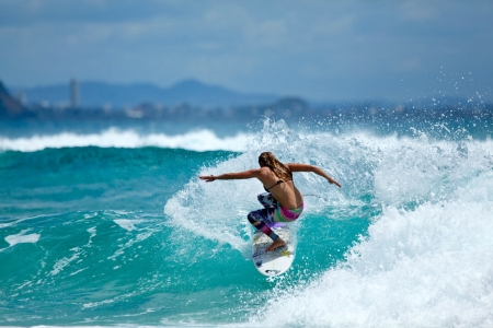 Surfer Riding a Wave - surfboard, surfer, woman, wave