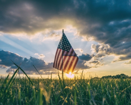 American Flag in the Field - Blue, Yellow, Stars, Red, Plains, Grass, White, Darkness, Patriotic, Brightness, Horizon, Glow, Clouds, Stripes, Flag