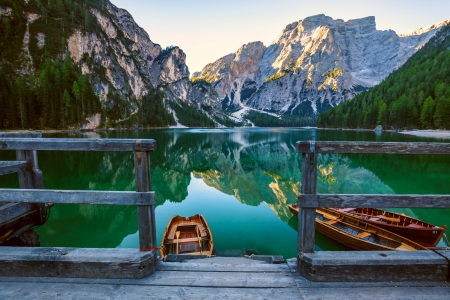 Lake Braies - Italy, mirror, Braies, tranquility, lake, rocks, pier, mountain, boat, serenity, dolomites, reflection