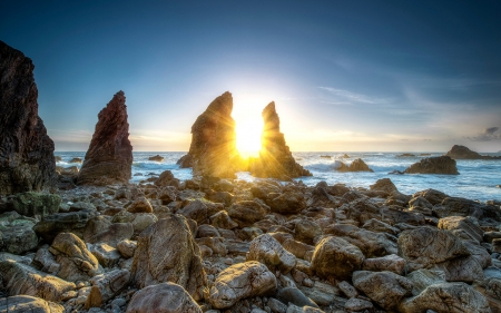Rocks Off The Coast - sun, stone, arch, cliff, nature, sunrise, coast, sea, rocks