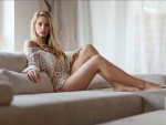 Blonde Posing on a Sofa