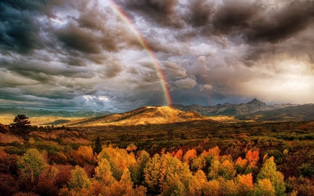 Rainbow Over Autumn - Dark, Landscape, Mountains, Trees, Green, Clouds, Autumn, Blue, Rainbow, Yellow, Purple, Rock, White, Rust, View, Gold, Red, Orange, Foilage, Scattered, Color