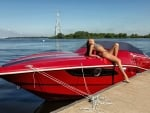 Bikini Model Posing on a Speedboat