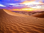 A desert underneath a colorful evening sky