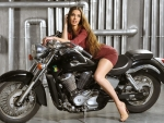 Model on a Honda Motorcycle
