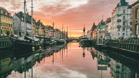 Sun setting at Nyhavn, Copenhagen, Denmark - good wines, excellent choices, beer and atmosphere, good food
