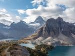 Mount Assiniboine soars above the changing foliage in British Columba, Canada