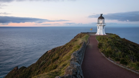 cape reinga lighthouse - sunrise, plants, sea, rocks, walkway, clouds
