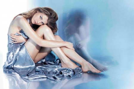Angela Lindvall - sitting, blue silk wrap, brunette, reflection, blue tinted image