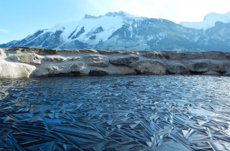 Frozen pond from Switzerland - ice, sky, alps, mountains