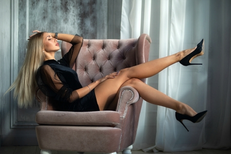 Model in Black with Sexy Legs - high heels, dress, model, legs, blonde, chair
