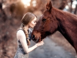 Girl Kissing her Horse