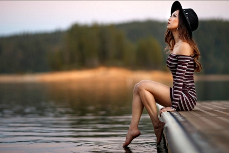 Pretty Model Sitting on a Dock