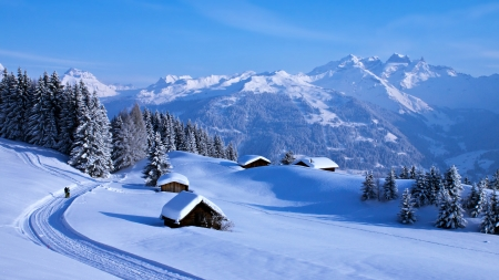 Winter in Swiss Alps - trees, snow, cabins, mountains, sky