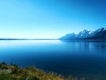 Side view of the Grand Tetons from across Jackson Lake in Wyoming