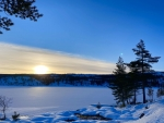 Sunset at 1 pm over a frozen lake, Fagerfjell, Norway
