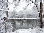 A reflective river after snowstorm in Flint Michigan