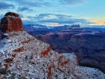 Snowy view of O'Neil Butte in the foreground and Zoroaster Temple in the background at sunrise in the Grand Canyon, Arizona