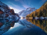 A perfect mirror during sunrise in Braies Lake, Dolomites, Italy