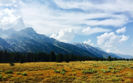 Grand Teton National park has great views from the road - wyoming, sky, clouds, landscape, usa