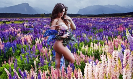 Gathering Flowers - Mountains, scenic, Model, flowers, sexy, lupines, field, sensous, brunette, femininity