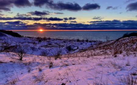 Sunset over snow-covered sand dunes, Berrien County, SW Michigan - sky, snow, winter, sun, usa, clouds