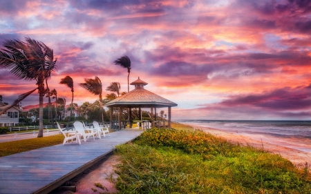 Watching Dawn on an island in South Florida - chairs, sunset, sky, clouds, gazebo, stormy, palms