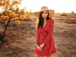 Pretty Brunette in a Red Dress and Hat