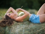 Cowgirl Relaxing on a Haybale