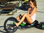 Riley Reid having fun on a tricycle