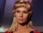 Grace Lee Whitney as Yeoman Janice Rand.