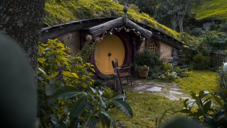 the hobbits house - new zealand, grass, door, rocks, flowers, trees
