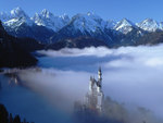 Neuschwanstein Castle in foggy mountain