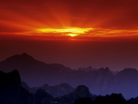 Huangshan at Sunset, China - china, sunsets, huangshan, red, amazing, mounts, awesome, blue, nice, sunlights, mountains, sunrises, cool, beautiful, purple, clouds, black