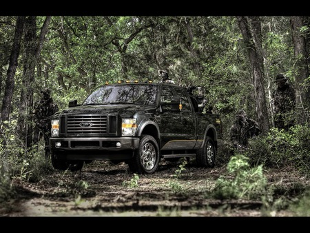2009 Cabelas superduty truck - 4 by 4, camo, big, hunting