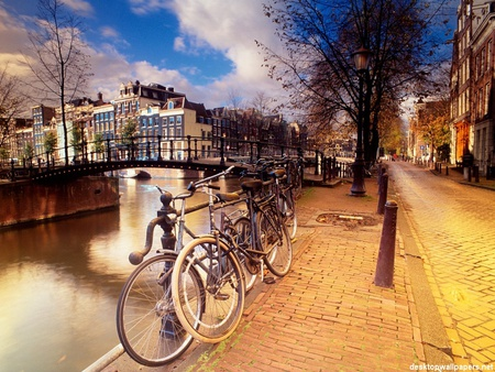 Beautiful scene - amsterdam, canal, buildings, post, bikes, trees, sky, water, reflections, bicycles, road
