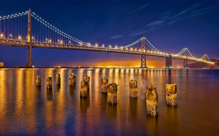 Sparkling Golden Bridge - reflection, lighting, river, golden, bridge, pillars, glow