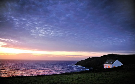 Lovely View - colorful, house, grass, cottage, beautiful, sunset, clouds, sea, lights, splendor, green, beauty, sunrise, reflection, amazing, lovely, view, houses, ocean, colors, waves, sky, purple, peaceful, nature, landscape