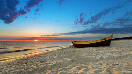 The ocean's tranquility - beach, boat, ocean, sunset, tranquility