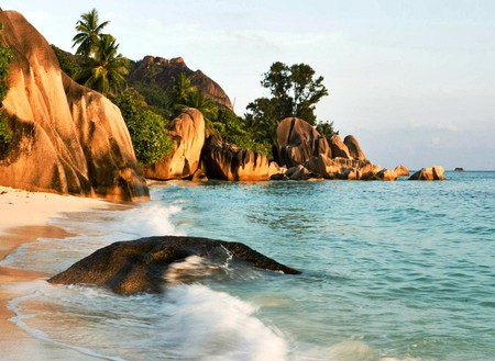 La Digue Island, Seychelles Islands - rocks, shore, orange, la digue, reefs, coasts, nice, stones, sunrises, islands, seychelles, ocean, coral, trees, water, cool, beaches, paradise, awesome, seascape, photoshop, beautiful, sea, photography, sand, green, azul, sunsets, blue, photo, amazing, colors, wawes, plants