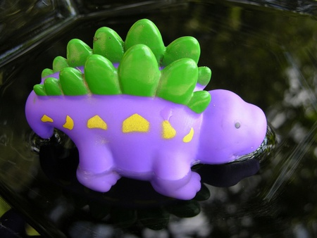 Stegosaurus drinking water in Jurassic period