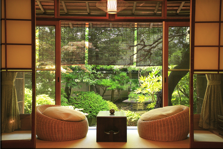 Zen room - candle, table, curtains, greenery, blinds, cushions, trees