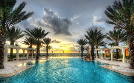 Pool - resort, shore, sun, umbrella, yellow, palm, sunset, clouds, palm trees, beach, splendor, beauty, sunrise, chair, swimming, tropics, reflection, umbrellas, holiday, ocean, relax, golden, sky, trees, pool, palms, water, paradise, rays, colorful, beautiful, sea, chairs, blue, hotel, amazing, exotic, view, swimming pool, colors, summer, hdr, nature, tropical, coast