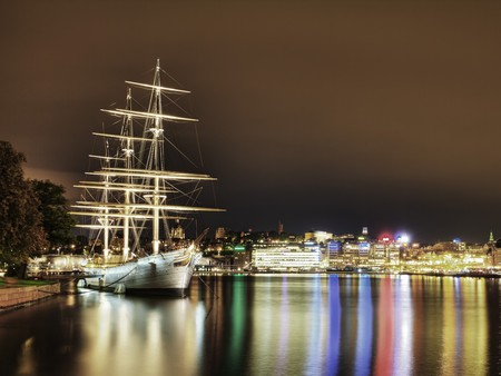 Sailboat - colorful, sailing, beautiful, lights, city, boats, boat, skyline, beauty, reflection, night, pier, buildings, colors, sky, trees, skyscrapers, water, peaceful, nature, sailboat, sailboats