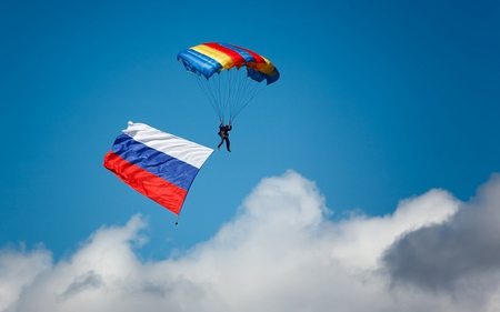 Up In The Sky - colorful, skydiving, colors, beautiful, sky, clouds, flag, parachute, nature, sports