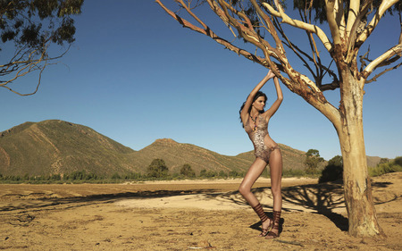 Walking the Wilds of Africa - suit, tree, model, people, bathing, striking, nature, beautiful