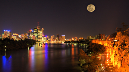 City Lights - lanterns, colorful, peaceful, skyscrapers, lights, streets, moon, full moon, night, road, sky, colors, trees, skyline, architecture, houses, reflection, beauty, beautiful, river, city, buildings, house, view