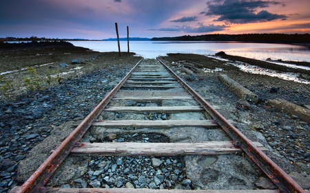 Tracks to nowhere - art, water, sea, railroad tracks, 3d, tracks, end, track, ways, beach, railroad, sunset, abstract, lake