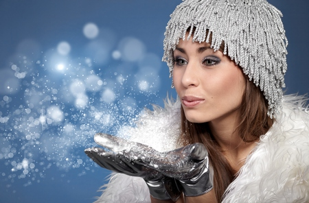 Magic - pretty, blower, beautiful, magic, woman, sweet, hair, she, photography, gloves, people, beauty, face, blue, female, lovely, colors, lips, winter, happy, brunette, hands, girl, snow, snowflakes, eyes, white